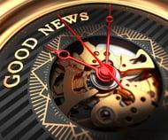 Good News on Black-Golden Watch Face with Closeup View of Watch Mechanism.