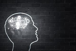Silhouette of human head with gears mechanism instead of brain.jpeg